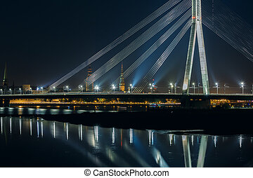 Old Town of Riga and River Daugava at night, Riga Cathedral, Saint Peter church and Riga castle in the background, Latvia