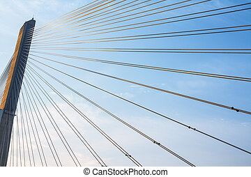 cable stayed bridge closeup in early morning against a blue...