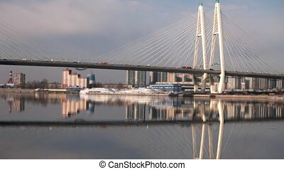 cable-stayed bridge reflected in the water