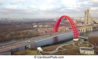 Cable stayed Picturesque bridge over Moscow river and car...