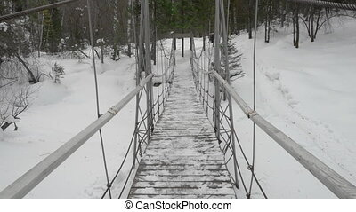 Cable suspension Bridge over Belokurikha river, winter