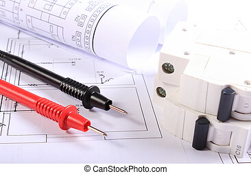 Cables of multimeter, electric fuse and electrical construction drawings of house, electrical drawings and tools for engineer jobs