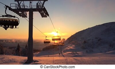 cableway in the sunrise light in ski resort