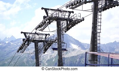 Modern ropeway with benches in amazing mountainous terrain.