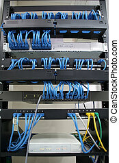 cabling rack with patch panels hubs and switches