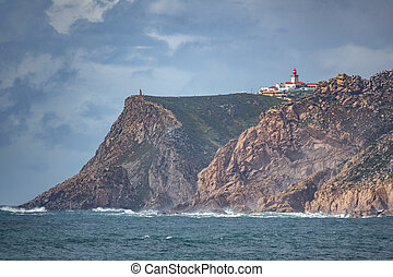 Cabo da Roca Lighthouse with small tourists - Cabo da Roca...