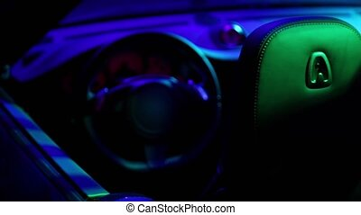 Cabriolet cabin in colorful illumination, closeup view from...