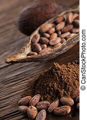 Cacao beans and powder and food dessert background -...