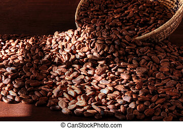 Cacao beans - Pile of raw cacao beans on wooden table with...