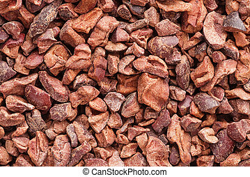 Cacao Nibs Background - close up image of cacao nibs...
