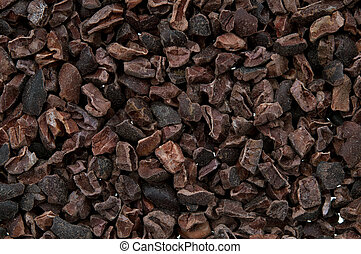 Cacao nibs isolated on white background