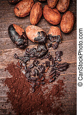 Cacao nibs on old wooden background