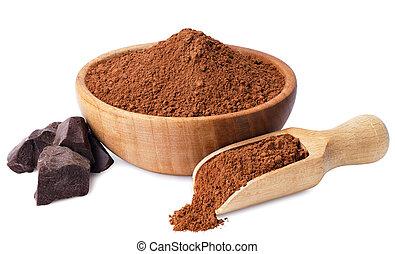 cacao powder in wooden scoop