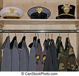 cadet uniforms from West Point Academy hanging neatly in closet with hats on shelve
