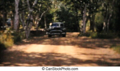 Cadillac 1956 Driving On Rural Road - An old black 1956...