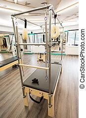Cadillac - Pilates equipment indoors. Cadillac close-up.