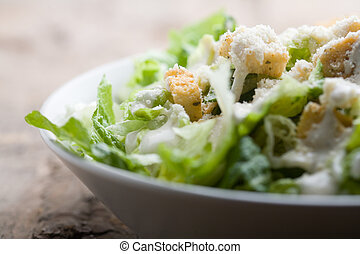 Ceasar salad with lots of dressing and parmesan