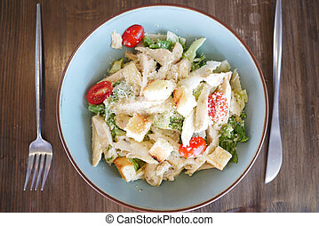 Caesar Salad in a bowl on table,