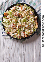 Caesar salad with chicken vertical top view