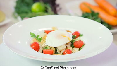 Caesar salad with poached egg