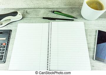 café, téléphone portable, stylo, cahier, bureau