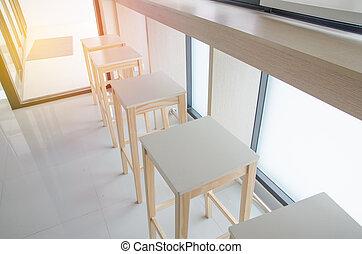 Cafe bar interior - wooden bar and bar chairs