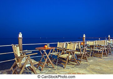 Cafe by the sea at night