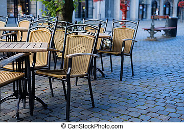 Cafe chairs outside in a street