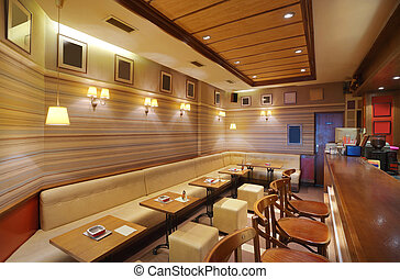 Cafe Interior - Cafe interior with wooden furniture,...