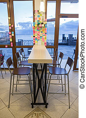 Cafe interior with a view of the sea promenade