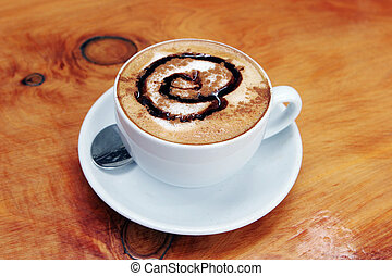 Cup of delicious hot cafe latte.