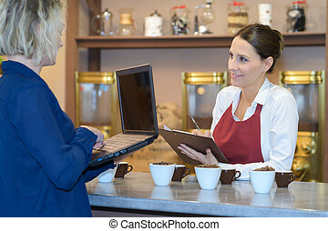 cafe owner in meeting with coffe supplier