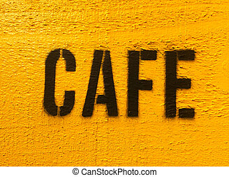 Cafe sign in black on yellow