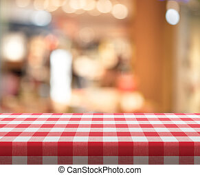 Cafe table with red checked tablecloth