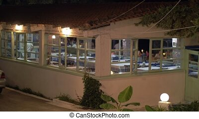 Cafe with visitors, evening view - Evening view of the cafe...
