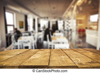 Wooden table and blurred cafe