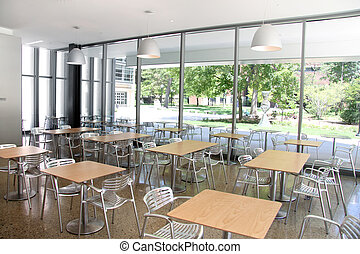 Elegant empty cafeteria with wooden tables and steel chairs