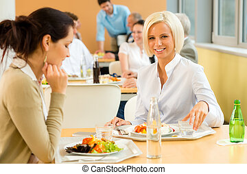 Cafeteria lunch young business woman eat salad at office...