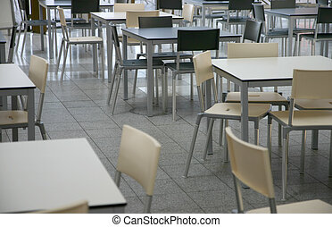 Cafeteria - Modern tables and chairs in a cafeteria