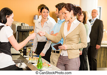 Cafeteria woman pay by credit card cashier
