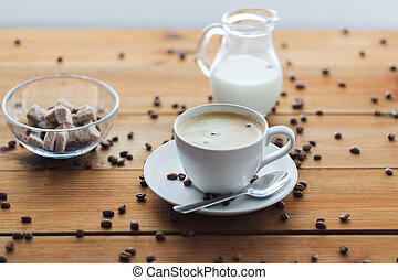 close up coffee cup and grains on wooden table