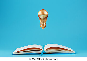 cahier bleu, concept, ouvert, idea., ampoule, doré, lévitation, arrière-plan.