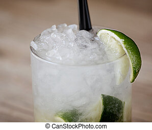 Caipirinha Cocktail - Caipirinha cocktail in a rustic...