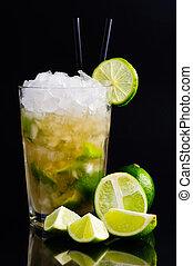 Caipirinha cocktail with limes on a dark background