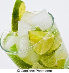Caipirinha cocktail with sliced lime