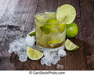 Caipirinha with Crushed Ice on wooden background