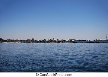 cairo on the nile - cairo city and small houses with boats...