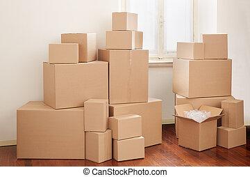cajas de cartón, en, apartamento