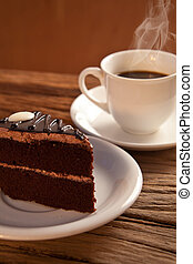 cake and coffee on old wood background