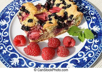 Cake and raspberries.